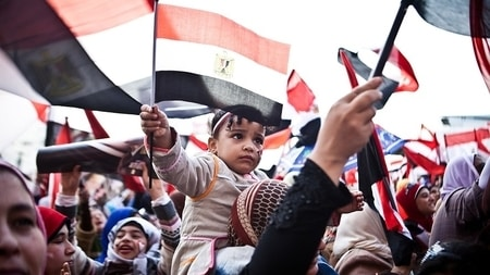 Social Studies: Egyptians wave flags during the 2011 Arab Spring